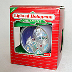 Click here to enlarge image and see more about item 4717: Hallmark Santa's On His Way 1986 Lighted Hologram Holiday Magic Ornament