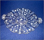 Click here to enlarge image and see more about item 4779: Fostoria Chintz Handled Cake Plate