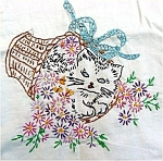 Click here to enlarge image and see more about item 4970: Kitten in a Flower Basket Embroidered Pillowcases To Finish With Edging