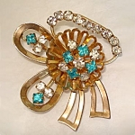 Click here to enlarge image and see more about item 5401: Blue and Clear Rhinestone Flower Bow Pin Brooch