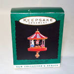 Click here to enlarge image and see more about item 6152: Hallmark 1995 Miniature Santa's Little Big Top Christmas Ornament