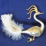 Click here to enlarge image and see more about item 6834-3: Fancy Gold Glitter On Ivory Glass Peacock Clip Christmas Ornament