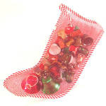 Mesh Christmas Stocking Filled With Bell Ornaments