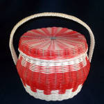 Click here to enlarge image and see more about item 7035: Red and White Woven Plastic Covered Sewing or Hair Curlers Basket