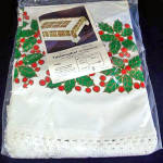 Click here to enlarge image and see more about item 7271: Stevens Christmas Holly 66 Inch Round Cotton Tablecloth Mint in Package