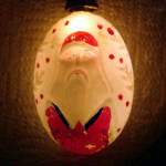 Click to view larger image of Large Oval Father Christmas Santa Figural Milk Glass Light Bulb, Working (Image2)
