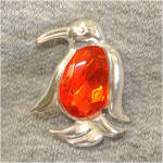 Click here to enlarge image and see more about item 8404A: Jelly Belly Orange Faceted Penguin Pin Brooch
