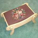 Click here to enlarge image and see more about item 8593: Flower Bouquet Needlepoint Sleigh Shape Foot Stool