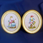 Click here to enlarge image and see more about item 9422: Pair Oval Renaissance Couple Needlepoint Pictures