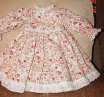 Click here to enlarge image and see more about item AGM0008: Lacy Pink Rose Print Dress for 18 Inch Dolls