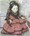 8 inch Madame Alexander brunette hard plastic Spanish girl doll, has Wendy face, moving brown eyes, and is a bending-knee non-walker from approximately 1965-1972. Her ensemble includes a red three-tiered Flamenco-type dress with black lace trim, a black lace mantilla with a red flower, her original gold loop pierced earrings, and black cloth shoes. Pre-owned doll's condition is excellent, no box, no tag, lovely coloring, outfit in excellent condition and complete. She has been restrung. No unpleasant smells. This is a very nice older doll, but she is not perfect.