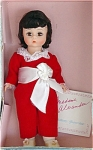 1987 Madame Alexander 8 inch Red Boy doll has a Wendy face, brunette wig, moving eyes, and rich rosy coloring. This doll represents the boy in the Red Boy painting. He is dressed in a red velvet suit with large white sash and white shoes. This is an outstanding retired doll is new and mint-in-the-box with booklet.