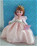 Madame Alexander 1994 8 inch Wendy Loves Being Prom Queen doll has an auburn wig, and moving green eyes. She is wearing a long full formal pink ball gown with gold dots, a pink chiffon shoulder wrap, a crown with jewels, and a wrist corsage. Mint-in-the-box old stock with tag, came directly from Alexander Doll Co. Expand listing to view both the photograph and the catalog picture.