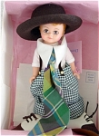 Madame Alexander 1996 8 inch 'Dressed Like Daddy' is a boy doll with a Maggie face with freckles; auburn wig, and blue moving eyes. This adorable little boy doll is dressed in green, white, and black print baggy, over-sized pants  with suspenders, a white shirt with a large collar and giant plaid tie, over-sized hat, and over-sized shoes. This doll is old stock that is mint-in-the-box with tag and came directly from Alexander Doll Co.