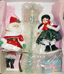 Madame Alexander 1996 doll set representing the characters in the movie, Miracle on 131st Street. This Christmas Holiday doll set includes an 8 inch brunette Wendy doll who is wearing a colorful taffeta plaid Christmas dress with a fur lined cape and hood, and Madame Alexander package, and a 10 inch Cissette doll as a slender Santa Claus with a white beard wearing a red suit with fur and bells to ring, and a street sign that only came with the complete set. The Cissette Santa has been on a diet. This retired doll set is new and mint with its tag; the box has a hole and is cannot be called mint, but the dolls and accessories are mint. Expand listing to view the photograph and catalog picture.
