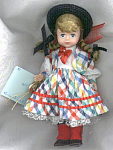 Click here to enlarge image and see more about item ALX0913: 1998 Madame Alexander Gigi Doll with a Maggie Face