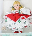 1998 Madame Alexander 8 inch Polly Put the Kettle On, is an 8 inch hard vinyl Wendy doll with blonde curly double ponytails tied with black and white checked ribbons, and moving blue eyes and freckles. She is wearing a full-skirted dress with household prints on white under a white lace edged red apron, white pantaloons, and red shoes. A golden kettle is included. This doll is discontinued, new, and mint-in-the-box with tag. Expand listing to view both photographs.