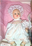 Click here to enlarge image and see more about item ALX0979: Madame Alexander 75th Anniversary Huggums Baby Doll 1998