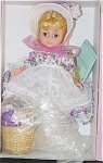 Madame Alexander 1999 8 inch  'Thinking of You',  Wendy doll has a blonde wig and blue moving eyes. Her ensemble includes a violet and pink blossoms print on white dress, lace-trimmed white apron, white straw bonnet with forget-me-not flowers, and white shoes. Her accessories include a natural straw basket of flowers and a little 'Thinking of You Card.' Discontinued doll is new and mint-in-the-box with tag. Expand listing to view all 3 photographs.