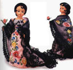 1999 Madame Alexander 10 inch Cissette Barcelona, is a glamorous fashion doll with tan skin, a brunette wig, and moving brown eyes. She is wearing a long pink formal evening gown with a large colorful floral print. Accessories include a long fringed black boa, earrings, flower, and high heels. There was also a larger Cissy doll wearing this terrific award-winning costume. Both Alexander Doll Company catalog and live photos are shown.  Retired doll was gotten directly from the company, and in her box with tag. However, she does have faint black marks from the black lace gloves that were put on her at the company. Price is reduced because of the flaw. She is actually new old stock, but she is being considered used. Expand listing to view both photographs and the catalog picture.