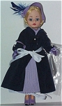 Madame Alexander 1999 Fall limited edition 1940's Parisian Chic doll with the 10 inch Cissette doll body and face. She was part of the Century Collection. She has a pale blonde wig looped in a back braid, and moving blue eyes.  Her ensemble includes a navy blue coat over a pleated lavender dress, lavender hat with blue feathers, lavender gloves, pearl earrings, lavender high heels, and lavender purse. New and mint in-the-box with tag old stock.