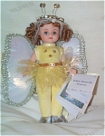 2000 Madame Alexander 8 Inch Yellow Butterfly Princess Doll from the Butterfly Magic Collection, No. 25680, has a Maggie face, a wig styled in auburn double ponytails with ringlets, and moving blue eyes with gold eye shadow. She is dressed in a yellow body suit with sequins and rhinestones; shimmering yellow skirt; silver, gold, and cream wings; corona; and silver slippers.  Doll is mint-in-box with tag and poem of butterfly queen and two butterfly princesses. Retired doll is new and mint-in-the-box, with tag. Expand listing to view both photographs.