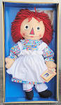 1997 Applause limited edition Mint-in-Box 16 inch Raggedy Ann Commemorative all-cloth Stamp Doll is still tied to and never removed from her original box.She has an outline nose, black button eyes, red yarn hair, and screened features. She has an I love you heart and a numbered body label. Her tag and certificate are included. She is wearing a multi-colored dress, white pinafore, and white pantaloons. Her outfit also includes black shoes and horizontal red and white stripe stockings. For the first time she was featured on a postage stamp honoring her 80th anniversary. New, mint-in-the-box old stock with tag, certificate, and box. LE. 7,500. Expand listing to view all 3 photographs.