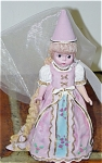 Madame Alexander 1999 Rapunzel figurine is a 6 inch bisque resin depicts the beautiful Wendy Rapunzel doll introduced in 1995. The figurine, like the doll, has very long blonde hair styled in a braid. She is dressed in a long pink Medieval-style gown with cone hat with a bit of cloth net.  It is one of several first series figurines by Alexander Doll Company. This  limited edition figurine is new old stock and mint-in-the-box with its certificate and packing box.