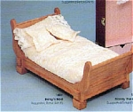 Robert Tonner 1997 bed for 14 inch Betsy McCall. It is the right size for similar size Tonner dolls like Child Jane, Barbara McCall, 14 inch Dru, Annie, and Pollyanna. The doll bed is made of natural wood. It is adorned with pale pink quilt-like bedding with embroidered flowers. New and mint in an unmarked plain shipping box. This is well-made and heavy. Shipping cost is based on shipping this only in its plain unmarked packing container.
