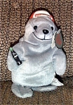 At approximately 7 inches in size, the Coca Cola Gray Seal bean bag plush is wearing a backwards red and white baseball hat with Coca Cola Logo, and he is holding a bottle of Coca Cola. This is Coca Cola Bean Bag No. 0107. This seal bean bag's tag is shaped like a Coca Cola bottle cap, and a Coca Cola label is on his body.  New and mint with tag. This bean bean bag plush is from the first edition of Coca Cola bean bags in 1997 and is retired. Expand listing to view both photographs.