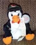 Small approximately 7 inch Coca Cola Penguin in Delivery Hat with Coca Cola Bean Bag plush, No. 0108. This Coke penguin is dressed in a green delivery hat that has a bottle cap with a Coca Cola Bottle and logo and a red bow tie. His tag is shaped like a Coca Cola bottle cap, and a Coca Cola label is on his body.  Mint with tag old stock. This bean bag plush was from the first set in 1997.