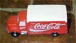 Coca Cola Delivery Truck Ceramic Figurine was made by Enesco from 1993-1994. The figure is 5 inches long. The ceramic figurine looks like a vintage red and white Coca Cola delivery truck. The figure is new and mint-in-the-box.