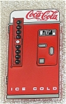 Enesco heavy plastic magnet of a vintage looking Coca Cola machine. It is mostly red and white. This refrigerator magnet is new and mint. It is from approximately 1993. On orders of 1 to 6 Coca Cola key chains and/or magnets, lower priced insured first class mail or first class mail international is available, if the request is put in the comments section of the order form; the total will be adjusted.