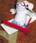 This 1993-1994 Dakin Coca Cola Polar Bear wearing red skies and blue goggles polyvinyl mini-figurine is about 1.5 to 2 inches tall. The tops of the skis advertise Coca Cola. This is new old stock. Insured first class mail shipping is available by request in the comments section of the order form  for 1-2 mini polyvinyl figurines. Shipping will then be adjusted by us.