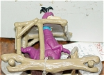 Click here to enlarge image and see more about item DFS0007: Flintstones Dino Dinosaur in Car PVC Figure 1994