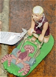 Click here to enlarge image and see more about item DFS0012: Dakin Barney Flintstones Figure with Mower 1994