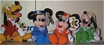 Set of 4 Mousketoys Quartet plush Mini-Bean Bags from Disneyland. Each character is approximately 8 inches tall. All quartet singers are wearing solid vests, straw hats with ribbons, and striped bow ties to match their outfits. Mickey Mouse is wearing blue and white performance attire; Minnie Mouse is dressed in orange and white; Pluto's outfit is red and white; and Goofy is wearing a green and white outfit. The price is for 1 set of 4 bean bags. This set was from around 1999-2000. The limited edition Quartet Donald is sold separately. Retired plush bean bags are in new and mint condition with tags.