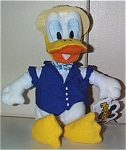 Mousketoys Quartet Disney Donald mini-beanbag, was an exclusive for Disneyland's annual pass holders. Donald Duck is between 7 and 8 inches in size. Donald's performance costume includes a straw hat with a blue ribbon, a blue vest, a blue and white striped bow tie, and his mouth is open for singing. These Donald mini bean bags were produced only a short time and sold inside Disneyland in Anaheim, California, around 1999-2000. Retired bean bag is mint with tag, and like new.