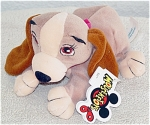 Lady from Disney version of 'Lady and the Tramp' bean bag, Mousketoys tag from Disneyland is a beige and white cocker spaniel with brown ears cocker spaniel-like dog from the Disney movie. A deep pink bow adorns her neck. Lady is about 8 inches in length. This bean bag came from Disneyland in Anaheim, California. Disney World and the Disney Store also had these, though the Disney Store version had a different tag. This mini bean bag plush is mint and with tag and body labels. Retired bean bag is from 1997-1998. Expand listing to view both photographs.