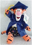 Disneyland Gradnite Tigger the Tiger from Winnie the Pooh and friends mini-bean bag is approximately 8 inches tall, and he is wearing printed Bermuda Shorts under his dark graduation robe, a dark blue graduation cap with a gold tassel, has foot pads and a straight tail, a Disneyland tag, and it is from 1999. He is ready to celebrate at Disneyland Gradnite the moment the ceremony is over. He was only available a short time around graduation. Old stock in like-new mint condition with its Disneyland tag.