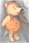 This Disney Pumpkin Pooh mini-bean bag 7-8 inches tall and he is wearing his Halloween costume of a smiling pumpkin suit with a green leaf-like collar, red sleeves; and he has pumpkin stem for hat. This Pooh has a hard nose and seamed feet. He has a Mousketoys tag from Disneyland and was available from late 1997-1998. Retired bean bag is mint with tag.
