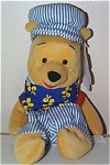 Disneyland Choo Choo Pooh with Mousektoys Tag mini-bean bag from Disneyland with a Mousketoys tag from around 1998. This Pooh Bear plush is approximately 7 to 8 inches tall. He is dressed in a dark blue and white striped railroad engineer hat with his ears sticking out, and blue with yellow floral print shirt. Retired, new, and in mint condition with tag.