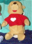 Disney Valentine's Day Winnie the Pooh bear is dressed in a knitted red sweater with a white heart mini-bean bag plush, has a Mousketoys Tag from Disneyland.  Winnie the Pooh is approximately 8 inches tall and is from around 1997-98. This discontinued bean bag Pooh bear is in new and mint with tag condition.