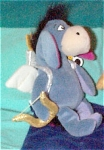 Disney Eeyore Donkey Cupid with Bow and Arrows mini-bean bag, has a Mousketoys Tag from Disneyland in approximately 1998 and was intended for Valentine's Day.  Eeyore is nearly 8 inches tall. Winnie the Pooh's friend has white wings and a golden bow and arrows so he can fly like Cupid and make one fall in love. Retired bean bag is new and mint with tag.