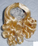 Blonde Kelly synthetic adjustable replacement wig with mid-length curls and a center part for 3.5 to 5 inch circumference hard plastic and composition doll heads.  This wig can adjust to fit a variety of dolls such as Tiny Betsy McCall, Vogue Ginny and Jill, Madame Alexander Alexander-kins and Cissette, Nancy Ann Storybook Muffie, Ginger, Pam, and many other 7.5 to 10.5 inch dolls.  It is in an attractive style. Manufactured for Dollsparts. The price is only for the wig, and not the doll modeling this style wig in a different color. New, mint-in-package.  Expand listing to view all 3 photographs.