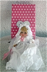 Effanbee 1995-1996 6 inch all-bisque Christening Baby Doll. This sitting petite baby doll has a blonde wig, fixed blue glass-like eyes, and a sweet face.  Her ensemble includes a long white with lace christening gown with a pink rosebud and a matching white cap. Discontinued doll is new and mint-in-the-box. Expand listing to view both photographs.