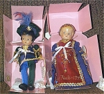 Set of 9 inch Effanbee Romeo and Juliet Patsyette boy and girl dolls, which are mint in separate boxes from 1997-early 1998. They are vinyl dolls with molded and sprayed hair and painted side-glancing eyes, and they look like the classic Effanbee Patsyette dolls of the 1920s and 1930s. The boy and girl dolls are wearing colorful blue, red, and gold outfits appropriate to the Italian Renaissance and Shakespearean play. The Romeo doll is wearing blue pants, jacket, and a large hat with a plume. The Juliet Patsyette doll's costume includes a blue dress with red and gold over-skirt.  Effanbee Heart bracelets are included. These retired dolls are mint-in-their boxes. These dolls are from Effanbee Doll Co., before Tonner acquired it.