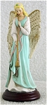 Click here to enlarge image and see more about item ENA0001D: Enesco Blue Angel with Flute Musical Figurine 1994