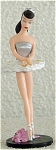 1994 Enesco Love series of Polyvinyl Figurine of the Classic Mattel Barbie doll with brunette ponytail, who is wearing a classic ballerina tutu with white with pink floral print short skirt, silver bodice, white ballerina shoes, and pink roses on black base. This figurine is 3 inches tall. It represents a Barbie doll from 1959 through the early 1960s dressed in an authentic costume from that period.  If only one figurine is desired, note in comments section of order form if you would like it sent by lower priced insured first class mail shipping. New and mint condition.