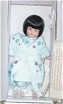 2005 Effanbee Dreams and Whimsies 9.5-10 inch Patsyette hard plastic doll with dark brunette hair in short bob with bangs and moving blue eyes. She is slightly taller than the Patsyette dolls with painted eyes. She is wearing blue floral print pajamas, a blue floral chenille robe with pockets and embroidered purple and teal flowers, teal slippers. She comes with a golden heart bracelet. This is a limited edition Robert Tonner designed doll and outfit. New, Mint-in-the-Box.